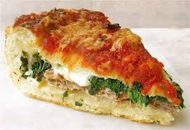 here s a good view of the layers crust then sausage mozzarella spinach and mushrooms crust tomato sauce and more cheese
