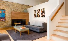 stacked stone fireplace in a living room with a dimensional stone panels used as the feature