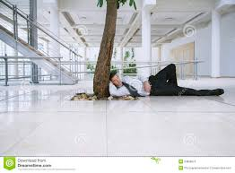 office tree. businessman resting under tree in office stock photos