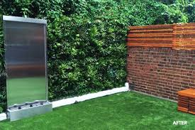 each easi wall panel is handmade with multi directional grass eco respectful recycled material strip dividers and skillfully selected plant arrangements