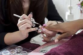 connie lee owner and head nail stylist at bling your nails left attaches