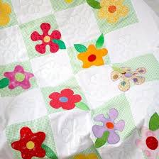 Handmade Flowers Nursery Patchwork Quilt & green gingham and white patchwork squares with bright flowers Adamdwight.com