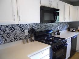fascinating black and white kitchen tiles design ideas with white kitchen0 cabinet and mosaic kitchen backsplash also black modern gas kitchen range