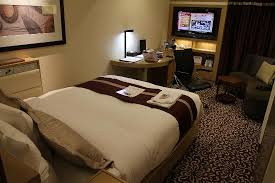 bedroom with tv and desk. Hotel Ryumeikan Tokyo: The Double Bed, Desk, TV, And Couch In Bedroom With Tv Desk