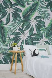 Go bold or go home with this statement tropical wallpaper. Showcasing a  selection of beautiful