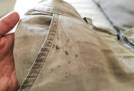 to remove oil sns from clothes
