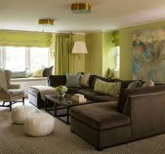 Green and brown living room features walls painted green lined with a a  large