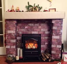 fake fireplace for made from cardboard bo and wallpaper