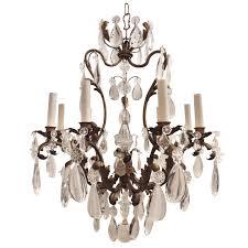 a wonderful nine light gilt metal and crystal chandelier maison metal and crystal chandelier