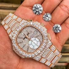 bust down patek and diamond rocks which are
