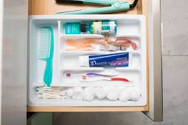 bathroom drawer organization: utensil organizers can be used in bathroom drawers