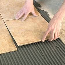 how to lay floor tiles installing tile without grout lines can you paint