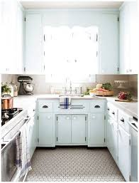 Photographer: Donna Griffith Source: House & Home June 2011 issue Products:  Stove, dishwasher, Frigidaire; marble countertop, York Marble; floor and  wall tiles, Olympia Tile faucet, American Standard; cabinet hardware, Lee  Valley Tools;