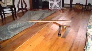 buckling hardwood floors above vented