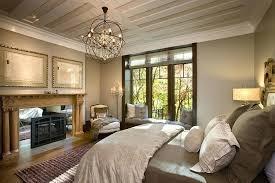 eclectic master bedroom with metal fireplace chandelier hardwood floors crown molding box restoration hardware orb chandelier