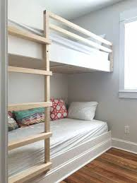 built in bunk beds built in wall to wall bunk beds before ladder is stained diy