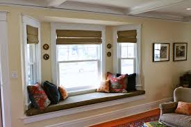 Living Room:Brilliant Bay Window Seat Design With Square Floral Cushion And  Laminated Wooden Flooring