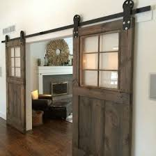 sliding barn doors with clear glass inserts make the look not too bulky and let the
