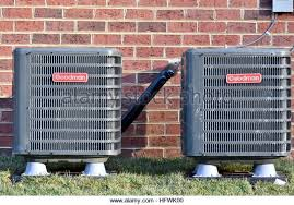 goodman ac unit. goodman air conditioning units outside a residential home - stock image ac unit