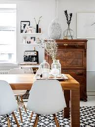 white chairs farmhouse table black and white rug dining room