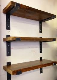 hand-welded from steel, these perfectly designed metal brackets by mc lemay  for lemay+rivenbark design lab features reclaimed wood shelves. the wood