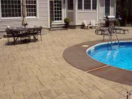 Stamped concrete pool deck with acid staining.