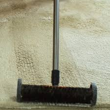 carpet brush. side wheels give support to the brush, keeping it from becoming buried in carpet brush a