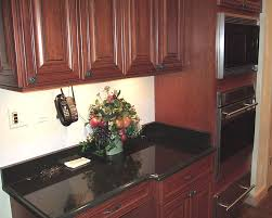 black absolute counter maple cabinets stained a cherry