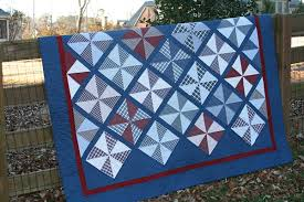 Quilting Memories: Quilts Made From Plaid Shirts & plaid pinwheels quilt with blue borders Adamdwight.com