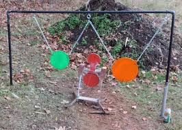 two steel plates hang from homemade target frame