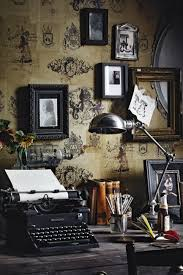 Vintage wallpaper coupled with gorgeous old typewriter and salon style hung  art make for an office or workspace worthy of any writer!