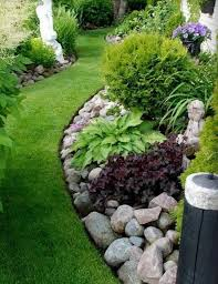 If you don't have room for a full river bed, you can landscape with river  rock by covering your garden beds with stone; Via