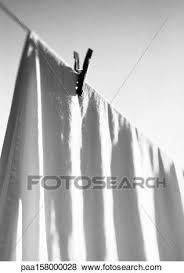 hanging sheet pictures of bed sheet hanging on line with clothes pin b w