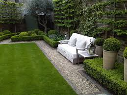 Small Picture lush green grass grey brick edging around garden beds box hedges