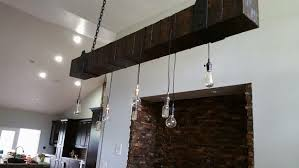 rustic wood beam chandelier with edison blub lights