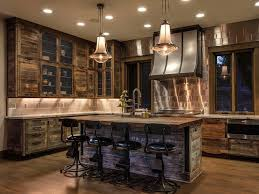 rustic kitchen island with wood countertops plus sink illuminated with two rustic pendant lamps on top with wooden kitchen cabinets and cupboards on wooden