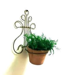 wall mounted flower pot holder pots lyre wire mount off the mounte