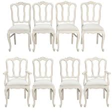 set of eight french white painted open back dining chairs for