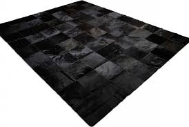 side view of black patchwork cowhide rug in 8 inches squares