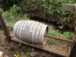 if you can use plastic drum barrels you can definitely use wine barrels as well perfect if you want something beautiful for your garden diy compost bin
