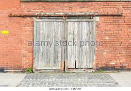 sliding garage doorsOld Wooden Sliding Garage Doors Stock Imagesliding Screen Cost