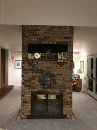 We have a large brick two-sided fireplace in the middle of our family room.  While kinda cool in theory, it feels like a big obstruction on most days.