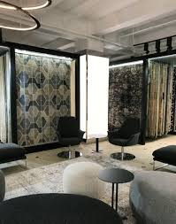 area rugs are showcased on racks dramatically integrated into the carpet art deco showroom s interior architecture rugs are the stars set within the