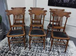 antiques by design griffin carved oak press back dining chairs
