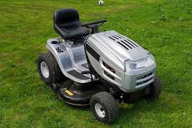 craftsman riding lawn mower green. silver and black riding lawn mower against mown grass background craftsman green m