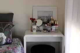 Makeup Vanity Ideas For Small Spaces Featuring Waterfall Desk With Small  Lean Back Framed Art Portrait And Acrylic Storage Boxes Plus Simple Black  Stool