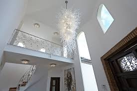 foyer with white walls and contemporary chandelier
