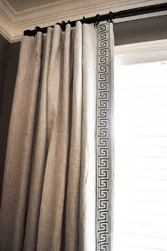 Drapery Panels on rings and drapery rod. This also has a decorative fabric  tape sewn