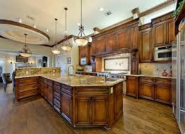 kitchen design entertaining includes: opulent details include natural stone flooring ornate crown moldings top of line stainless steel appliances state of the art media room two kitchen