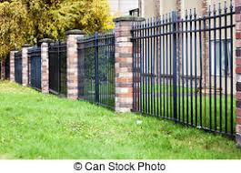 wrought iron fence brick. Brick And Metal Fence In Urban Community Wrought Iron